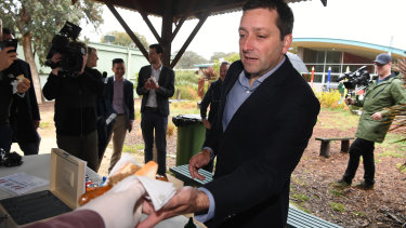 Matthew Guy with his democracy sausage on Saturday morning.