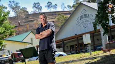 Publican Greg Brick in front of his Buchan hotel, which was rebuilt after burning down five years ago. This time he lost his house and farm.