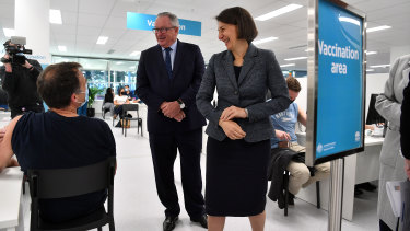 NSW Premier Gladys Berejiklian and NSW Health Minister Brad Hazzard during a tour of the NSW Vaccination Centre at Sydney Olympic Park as people in their 40s get their Pfizer shots.