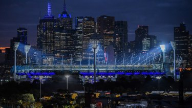 Some buildings in Melbourne turned blue in a tribute to the four police officers who died on the Eastern Freeway a year ago.