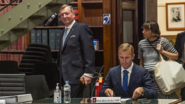 Landcom chief executive John Brogden, left, and Planning Minister Rob Stokes at the budget estimates hearing on Tuesday.
