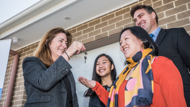 ACT Housing Minister Yvette Berry hands over the first keys to Christine Van and daughter Chloe,15.