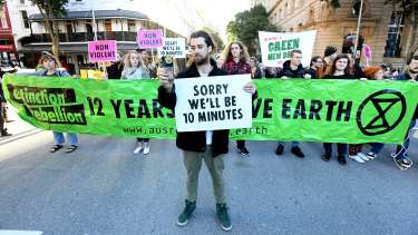 Extinction Rebellion protesters held placards and banners in front of many infuriated drivers.