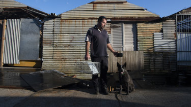 Sydney rat catcher Chris McGreal holds a rat trap at his property in Ingleside.