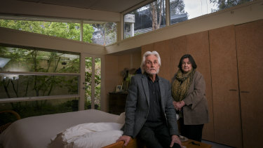 Jan and Gary Hancock in their Eltham home, with the neighbouring property overlooking them.
