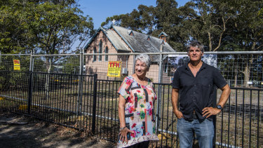 Historian Shirley Fitzgerald and Alfred Wellington, the head of the Jerrinja Local Aboriginal Land Council, in front of the Holy Trinity Family Church in Huskisson on the NSW South Coast.