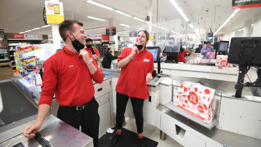 Coles workers Brad Wilkinson and Mia Belic removed their masks at 6pm Friday when mandatory face coverings were lifted.