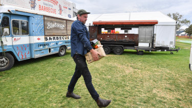 Chris Terlikar from Bluebonnet food truck packs up after the cancellation of the grand prix.