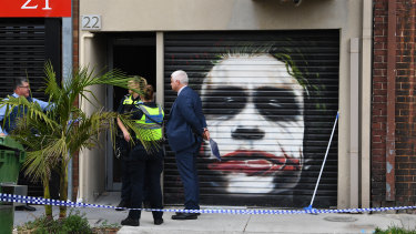 Police outside the Port Melbourne property where one of the alleged killers was arrested.