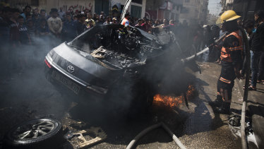 The wreckage of a vehicle following an Israeli air strike in Gaza City on Sunday.