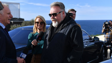 Kyle Sandilands outside John Ibrahim's home on Tuesday.