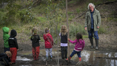 Bush kinder educator Doug Fargher with children at the Darebin Parklands.