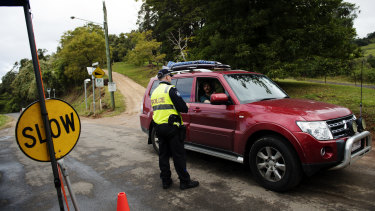 Commuters are stopped by police at the Queensland-NSW border checkpoint in the Gold Coast hinterland.