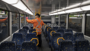 Sydney trains cleaner on a Tangara Train at Mortdale Depot.