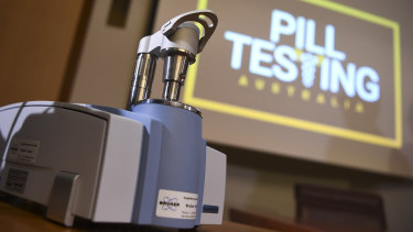 A Compact FTIR Spectrometer pill testing machine is seen during a demonstration event at Parliament House in Canberra.