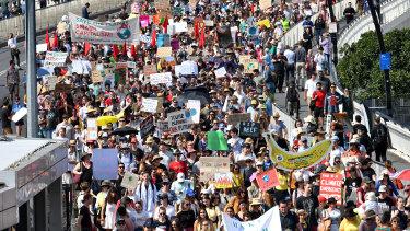 Climate change protesters are seen crossing the Victoria Bridge.