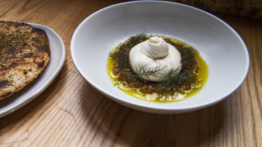 Burrata with fennel jam and wood-fired flat bread at Nomad.