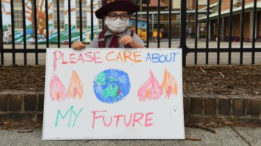 Scarlett Rigato, 5, holds a sign during a climate change protest by parents and students in Sydney last year.