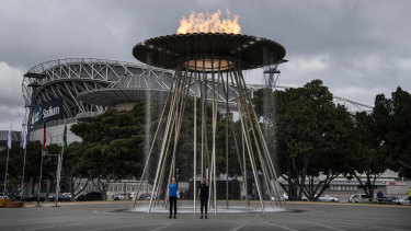 The Olympic cauldron is lit on Tuesday.
