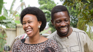 Uganda's leading opposition challenger Bobi Wine, right, and his wife Barbie Kyagulanyi, in cheerful mood after casting their votes in Kampala.