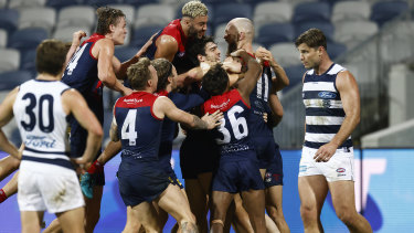 Max Gawn is mobbed after kicking the match-winning goal after the siren.