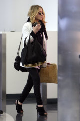 Mary Kate Olsen holding a bag from Net-A-Porter's top styles.