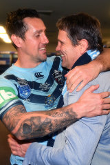 Mitchell Pearce of the Blues embraces his father Wayne following their series-sealing win over the Maroons.