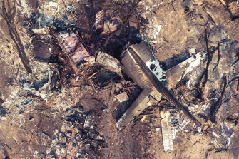 The tail of the C-130 Hercules that crashed on Thursday lies amid debris in southern NSW.