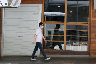A man walks past a closed restaurant. Spending through the nation's restaurants has fallen 38 per cent on the same time last year, according to the Commonwealth Bank.