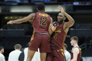 Loyola's Marquise Kennedy and Keith Clemons celebrate their win.