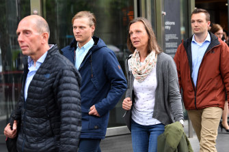 The family and former partner Thomas Kleinegris (second from left) of Dutch cyclist Gitta Scheenhouwer leaves the County Court in Melbourne