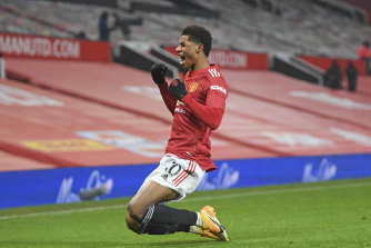 A jubilant Marcus Rashford celebrates his stoppage-time winner against Wolves at Old Trafford.