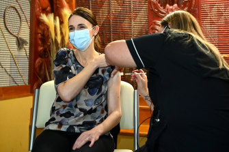 New Zealand Prime Minister Jacinda Ardern receives her first Pfizer vaccination on Friday. Ardern's first dose comes just over four months after the first person was vaccinated in New Zealand.