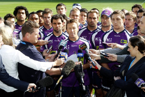 Craig Bellamy reads a statement in front of Melbourne players in April 2010 after the cap penalties were announced.