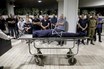 Mourners attend the funeral of Leah Yom Tov, 63, who was killed when a rocket fired from the Gaza Strip hit her house in Rishon Lezion, Israel.