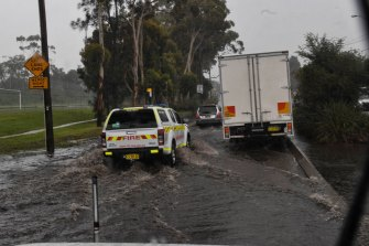Heavy showers cause flooding along Forest Road, Belrose, on Sydney's northern beaches, on Monday.