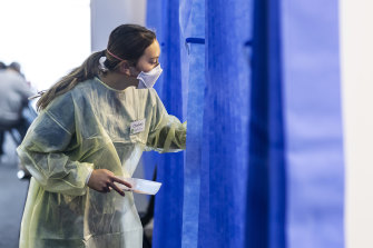 A health worker in a vaccination hub at Whitten Oval on Saturday.