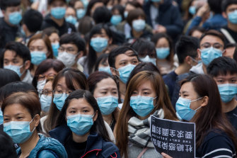 Medical workers wearing protective masks gather during a protest outside the Hospital Authority's head office in Hong Kong on Tuesday.