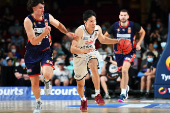 Yudai Baba on the run for Melbourne United in their clash with the Adelaide 36ers earlier this month.