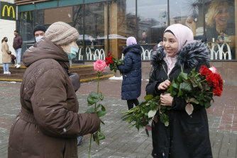 An activist in a hijab presents a flower to a woman passerby to mark the World Hijab Day in Kyev, Ukraine, on February 1.