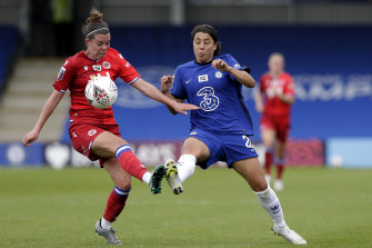 Reading's Deanna Cooper and Chelsea's Sam Kerr fight for possession of during their Barclays FA Women's Super League clash at Kingsmeadow on Sunday.