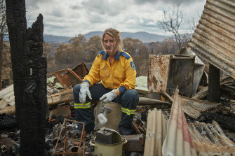 Anika Craney in the burnt-out remains of her home.
