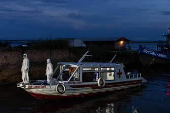 A floating ambulance bearing coronavirus patients arrives in Manacapuru, Amazonas state, Brazil.