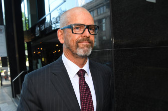 Former Victoria Police Chief Commissioner Simon Overland departs the Royal Commission into the Management of Police Informants on Tuesday.