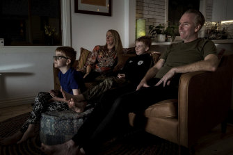 Glued to the screen: Zoe Shurgold and Paul McAleer with sons Dylan, 10, and Myles, seven.