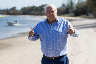 The Electoral Commission of Queensland has taken businessman and former MP Clive Palmer to court to determine whether he is a property developer.