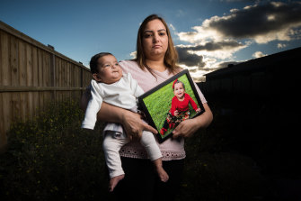 Harpinder Kaur Romana with her youngest daughter Arzoyi and a picture of oldest daughter Ashlyn. The family has been separated from Ashlyn for more than a year.