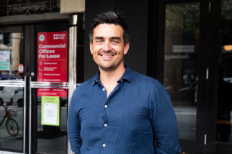 Alex McCauley, chief executive officer of StartupAus, outside the office he rents with friends.