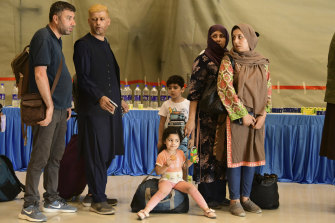 People evacuated from Kabul arrive at Hindon Air force base near New Delhi, India on Sunday. Their flight carried 168 people, according to an Indian government spokesman.