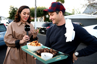 New Zealand Labour Party leader Jacinda Ardern's partner Clarke Gayford delivers home-cooked food to the media waiting outside their house in Auckland.